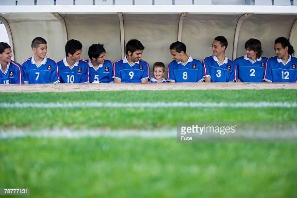Mascot and Soccer Team at Stadium