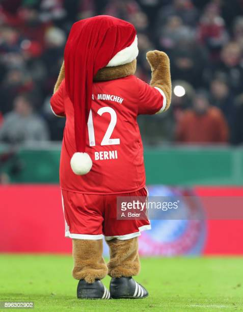 Mascot Berni of FC Bayern Muenchen celebrates his team's victory of the DFB Cup round of sixteen match between FC Bayern Muenchen and Borussia...