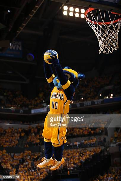 Mascot Boomer the Panther of the Indiana Pacers goes up for the dunk against the Washington Wizards during Game One of the Eastern Conference...