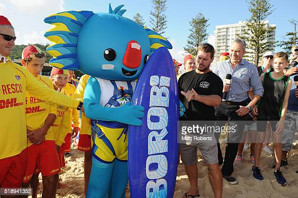 Mascot Borobi poses with Mark Occhilupo on the beach during the Official Reveal of GC2018 Mascot and Two Years to Go Celebrations at Burleigh Heads...