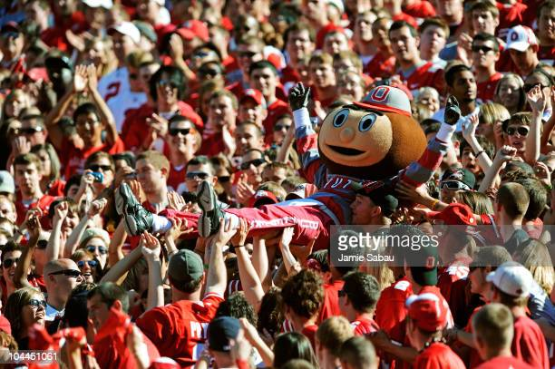 Mascot Brutus Buckeye is carried up the stands by fans during a game against the Eastern Michigan Eagles at Ohio Stadium on September 25 2010 in...