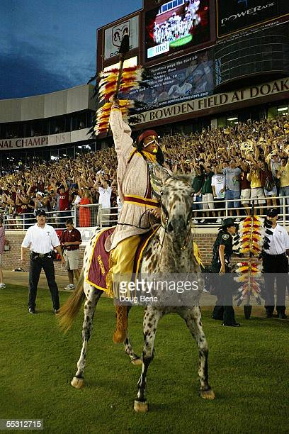 FSU mascot Chief Osceola and his horse Renegade of the Florida State Seminoles pumps up the crowd to start the game against the Miami Hurricanes at...