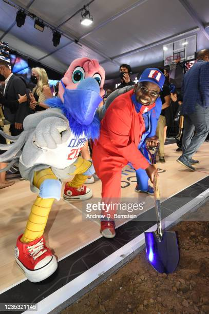 Mascot Chuck of the LA Clippers and team superfan Clipper Darrell pose during the LA Clippers ground breaking on Intuit Dome on September 17, 2021 in...