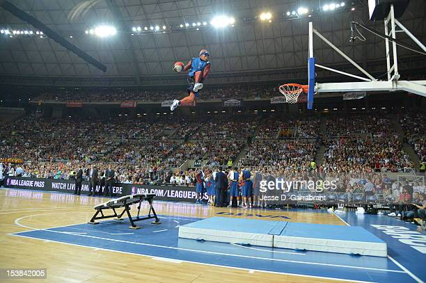 A mascot dunks during the Dallas Mavericks against FC Barcelona Regal game during the game at Palau St Jordi for NBA Europe Live 2012 on October 9...