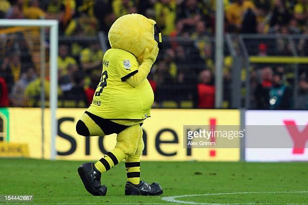 Mascot 'Emma' of Dortmund reacts after the Bundesliga match between Borussia Dortmund and FC Schalke 04 at Signal Iduna Park on October 20 2012 in...