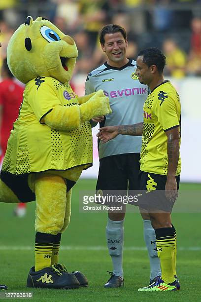 Mascot Emma Roman Weidenfeller and Antonio da Silva of Dortmund celebrate the 40 victory after the Bundesliga match between Borussia Dortmund and FC...