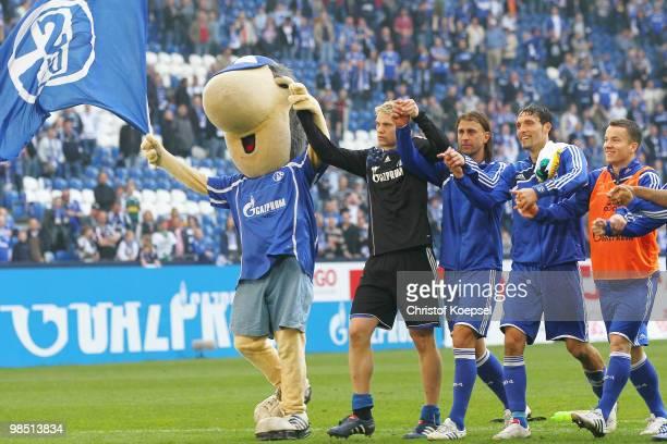 Mascot Erwin goalkeeper Manuel Neuer Marcelo Bordon Kevin Kuranyi and Alexander Baumjohann of Schalke celebrate the 31 victory after the Bundesliga...