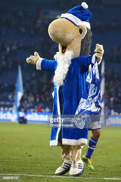 Mascot Erwin of Schalke celebrate after the Bundesliga match between FC Schalke 04 and SC Freiburg at VeltinsArena on December 15 2013 in...
