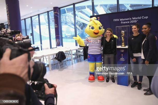 Mascot Ettie of the FIFA Women's World Cup 2019 France pose with Marinette Pichon of France Carli Lloyd of USA and Laura Georges of France next to...