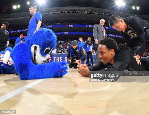Mascot Franklin of the Philadelphia 76ers plays rock paper scissors with DeMar DeRozan of the Toronto Raptors at Wells Fargo Center on January 15...