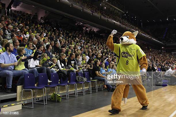 Mascot 'Fuchsi' celebrates during the Toyota handball Bundesliga match between Fuechse Berlin and TV Grosswallstadt at the MaxSchmelingHalle on...