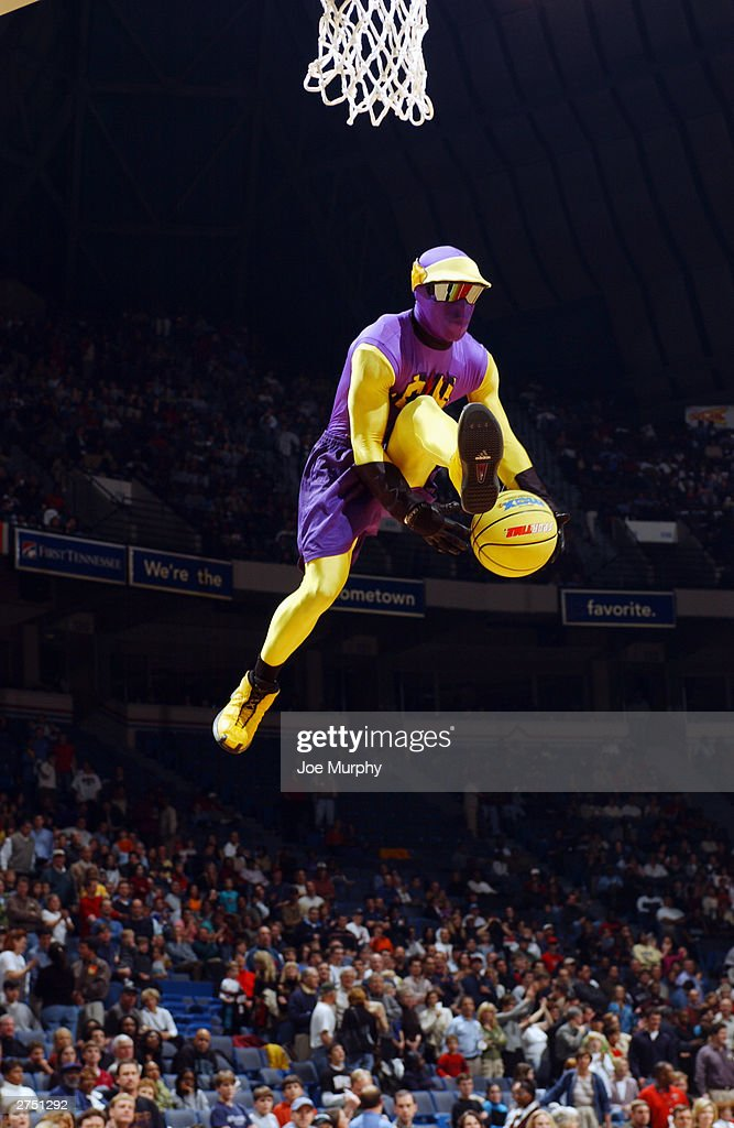 A mascot goes up for a slam dunk during the game between the Memphis Grizzlies and the Dallas Mavericks at The Pyramid on November 15, 2003 in Memphis, Tennessee. The Grizzlies won in overtime 108-101.