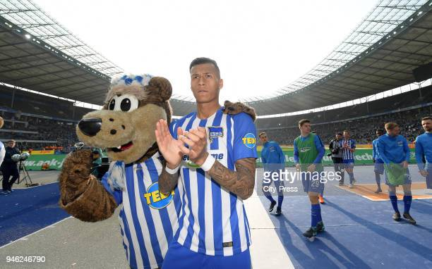 mascot Herthinho and Davie Selke of Hertha BSC after the Bundesliga game between Hertha BSC and 1st FC Koeln at Olympiastadion on April 14 2018 in...
