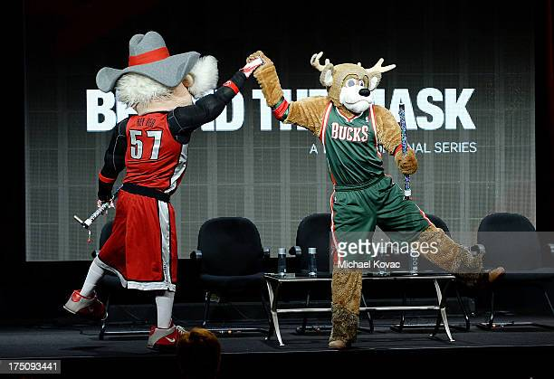 UNLV mascot Hey Reb performed by Jon 'Jersey' Goldman and Milwaukee Bucks' mascot Bango performed by Kevin Vanderkolk appear onstage during the...