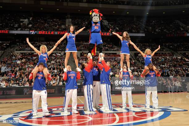 Mascot Hooper of the Detroit Pistons stands atop a pyramid with the Pistons cheerleaders during the game against the Philadelphia 76ers on March 29...
