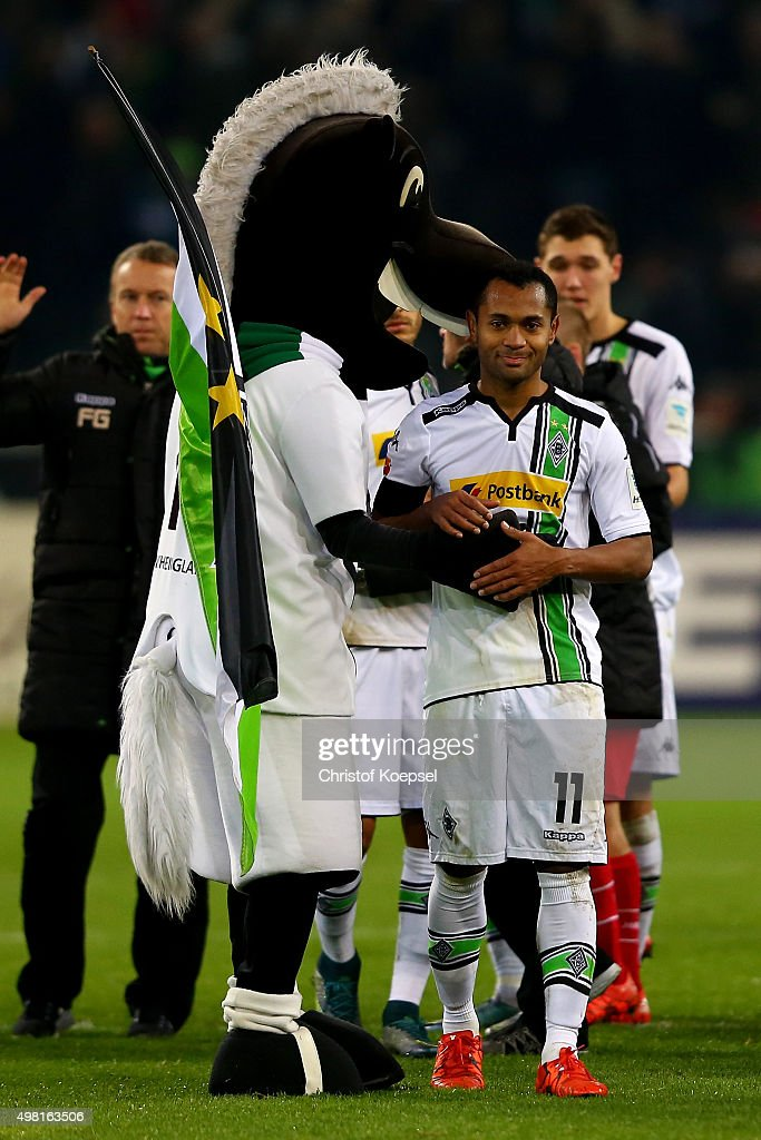 Mascot Juenter and Raffael of Moenchengladbach celebrates after winning 2-1 the Bundesliga match between Borussia Moenchengladbach and Hannover 96 at Borussia-Park on November 21, 2015 in Moenchengladbach, Germany. The match between Moenchengaldbach and Hannover ended 2-1.