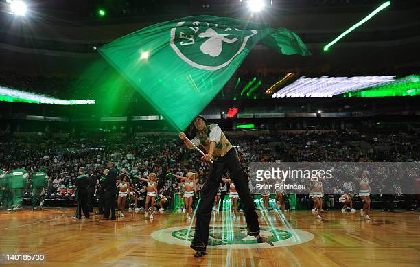 Mascot Lucky of the Boston Celtics gets the crowd pumped up before the game against the Milwaukee Bucks on February 29 2012 at the TD Garden in...