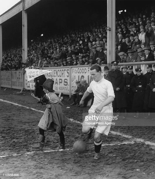 Mascot Miss Waters leading out the Swansea City team before an FA Cup sixth round match against Arsenal at the Vetch Field Swansea 6th March 1926...