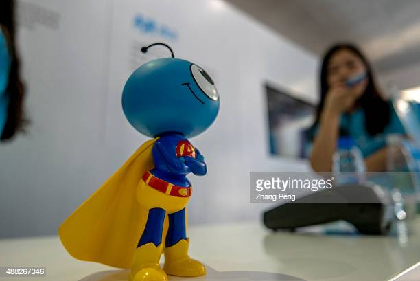 Mascot of Ant financial dressed as a superman on an exhibition In August Alibabas Ant Financial has just launched an integrated wealth management app...