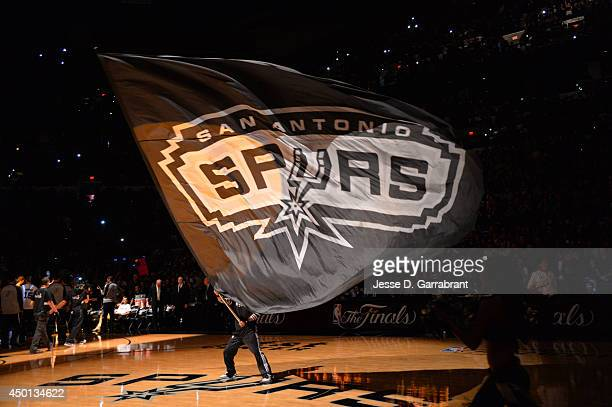Mascot of the San Antonio Spurs holds the logo up during a timeout against the Miami Heat during Game One of the 2014 NBA Finals on June 5 2014 at...