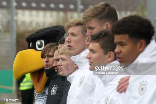 Mascot Paule and the German bench stand together during their national anthem prior the Uefa Elite Round game between Germany U17 and Slovenia U17 on...