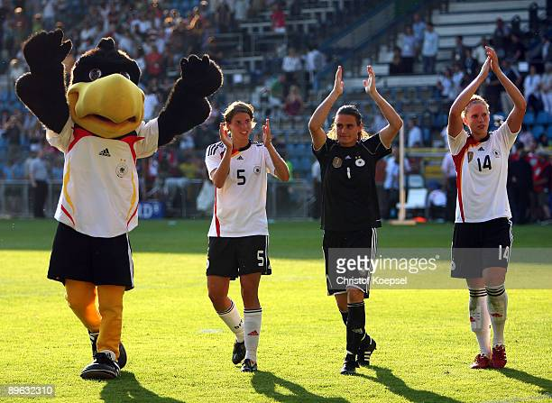 Mascot Paule Annike Krahn Nadine Angerer and Kim Kuhlig of Germany celebrate the 31 victory after the Women's international friendly match between...