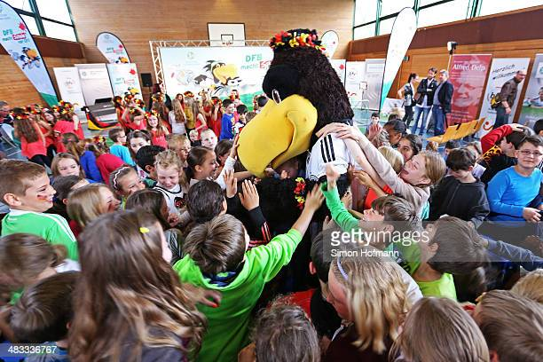 Mascot Paule attends a visit of Dzennifer Maroszan and Annike Krahn at Adolf Delp Elementary School on April 8 2014 in Mannheim Germany