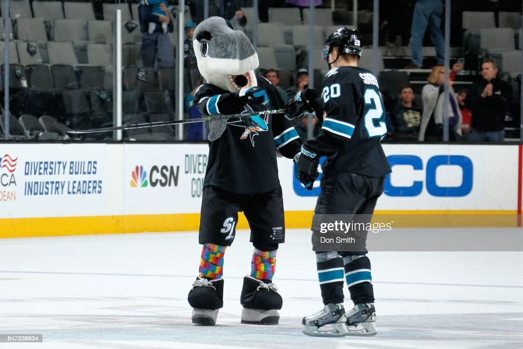Mascot, SJ Sharkie congratulates Marcus Sorensen #20 of the San Jose Sharks after a NHL game against the Vancouver Canucks at SAP Center at San Jose on March 2, 2017 in San Jose, California. The Sharks defeated the Canucks 3-1.