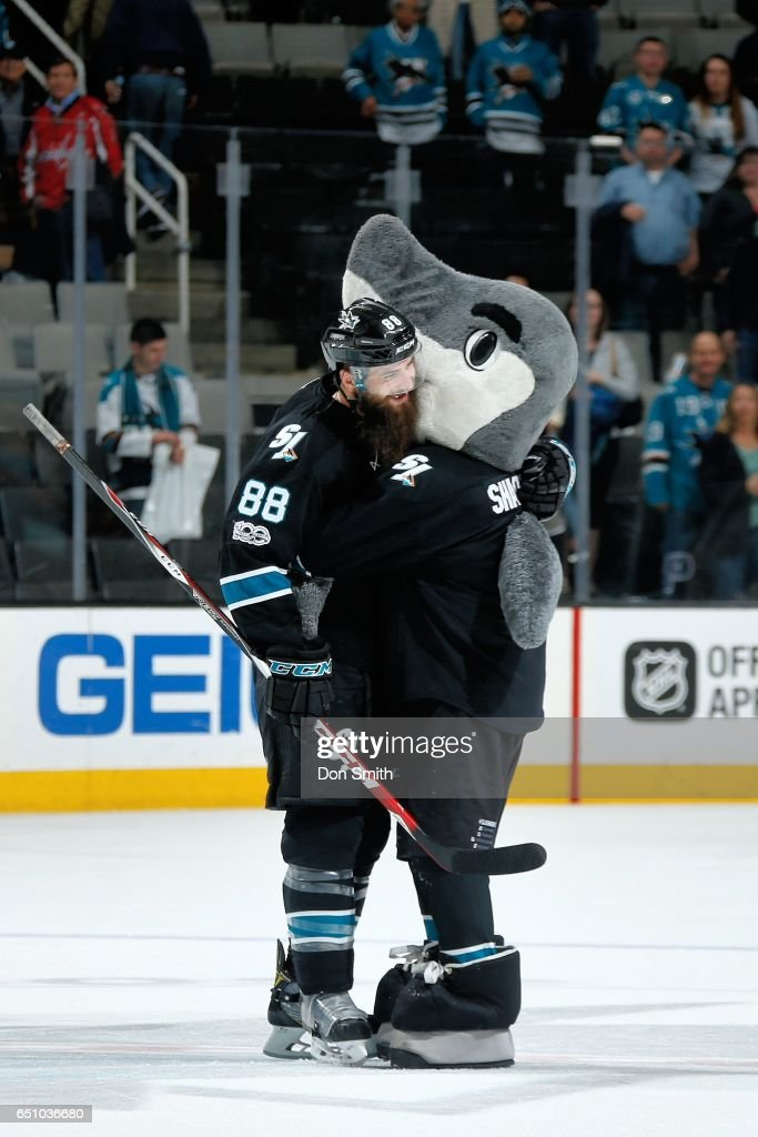 Mascot, SJ Sharkie of the San Jose Sharks gives first star of the game, Brent Burns #88 a hug after a NHL game against the Washington Capitals at SAP Center at San Jose on March 9, 2017 in San Jose, California. The Sharks defeated the Capitals 4-2.