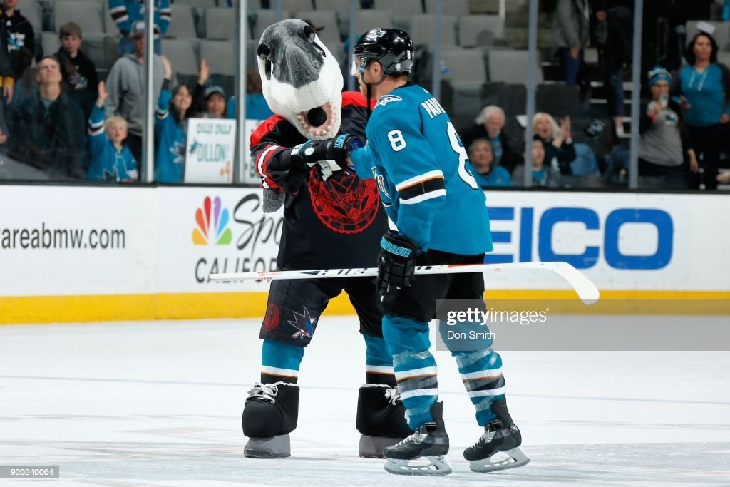 Mascot, S.J. Sharkie wearing his Lunar New Year Jersey celebrates the Shark's win over the Dallas Stars with Joe Pavelski #8 at SAP Center on February 18, 2018 in San Jose, California.