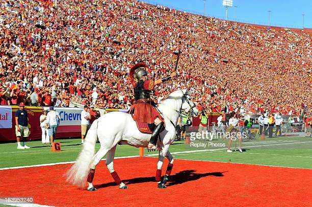USC mascot Traveler the noble white horse appears with a regal Trojan warrior astride prior to a game between the Hawaii Warriors and the USC Trojans...