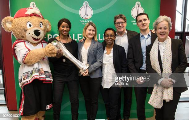 Mascot TropS Liz Baffoe Sonja Fuss Shary Reeves Harald Toni Schumacher Manuel Hartmann head of competitions at DFB and Agnes Klein pose with a trophy