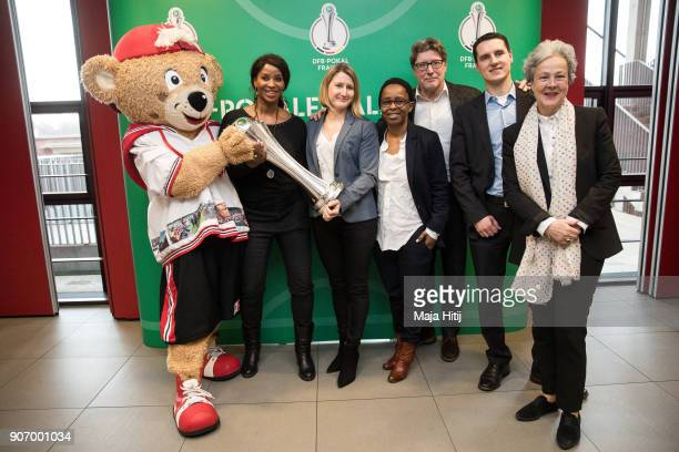 Mascot TropS Liz Baffoe Sonja Fuss Shary Reeves Harald Toni Schumacher Manuel Hartmann head of competitions at DFB and Agnes Klein pose with a trophy...
