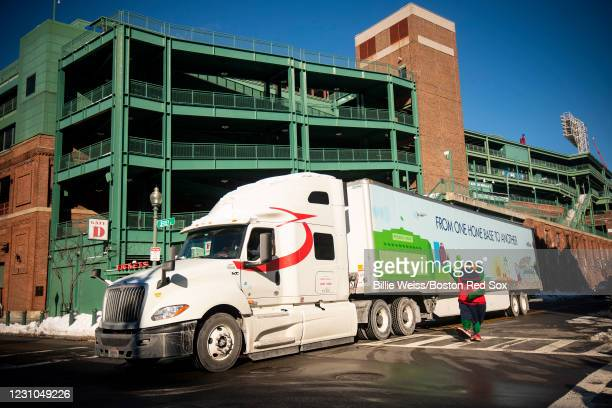 Mascot Wally the Green Monster waves as the truck departs for jetBlue Park during 2021 Boston Red Sox Truck Day on February 8, 2021 at Fenway Park in...