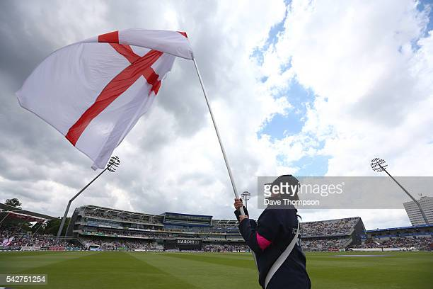 BIRMINGHAM ENGLAND JUNE 24 A mascot waves an England flag before the start of the 2nd ODI Royal London One Day match between England and Sri Lanka at...