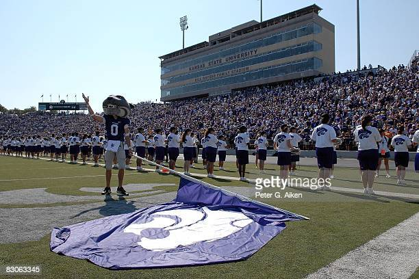Mascot Willie Wildcat of the Kansas State Wildcats looks up into the crowd holding a flag before a game against the Louisiana-Lafayette Ragin' Cajuns...