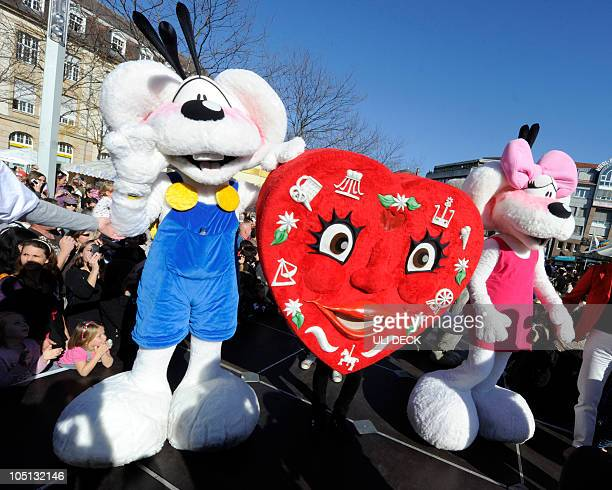 Mascots Diddle and Diddlina parade with a heart among a total of 166 mascots in the streets of Karlsruhe southern Germany during an international...
