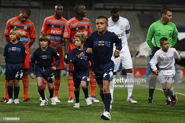 Mascots display the UEFA 'Unite Against Racism' logo during the UEFA Champions League Group F match between Olympique de Marseille and Arsenal FC at...