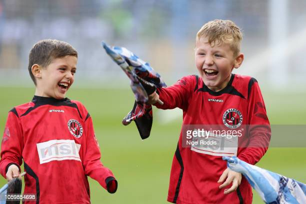 Mascots enjoy the pre match atmosphere ahead of the Premier League match between Huddersfield Town and West Ham United at the John Smith's Stadium on...