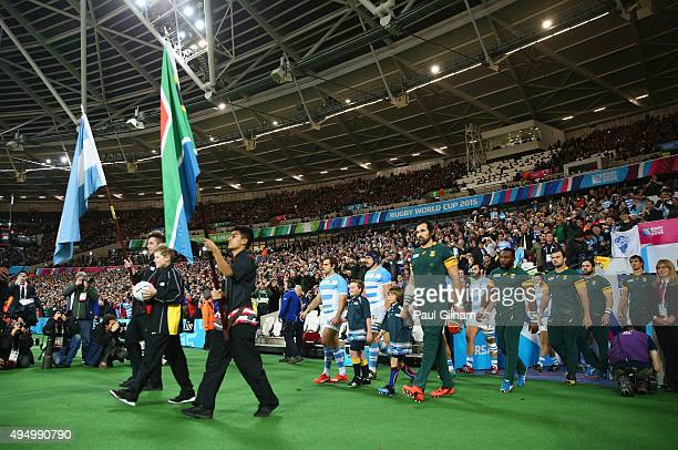 Mascots flag bearers and the ball carrier lead out the teams prior to the 2015 Rugby World Cup Bronze Final match between South Africa and Argentina...