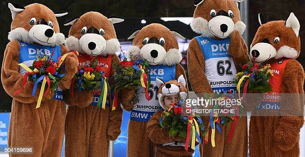 TOPSHOT Mascot's follow the winner ceremony of the men's 125 kilometer pursuit competition at the Biathlon World Cup on January 09 2016 in Ruhpolding...