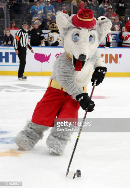 Mascots Harvey the Hound of the Calgary Flames plays the puck during the mascot showdown as part of the 2020 NHL AllStar Game weekend at the...
