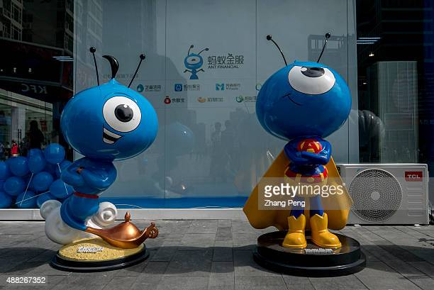 Mascots of Ant financial on an exhibition one plays the role of Aladdin the other is superman In August Alibabas Ant Financial has just launched an...
