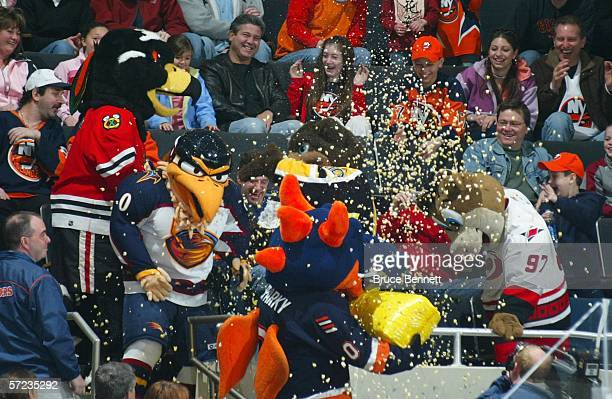 Mascots participate in a popcorn fight on Mascot Day during the game between the Philadelphia Flyers and the New York Islanders on April 2 2006 at...