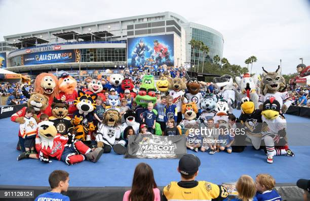 NHL mascots pose for a group photo with young fans during the PreGame Mascot Showdown at Amalie Arena on January 27 2018 in Tampa Florida