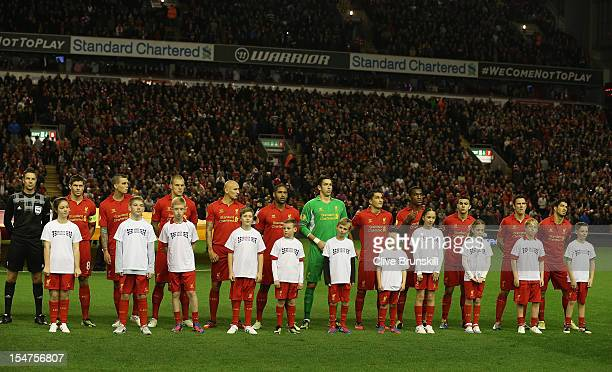 Mascots wearing Unite against Racism TShirts line up with the Liverpool players prior to the UEFA Europa League Group A match between Liverpool FC...