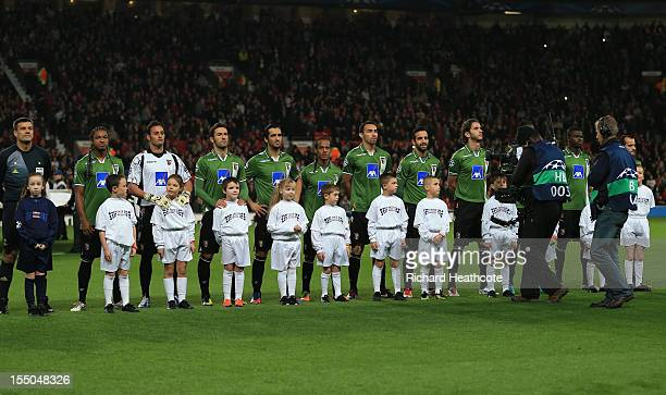 Mascots wearing Unite against Racism Tshirts pose with the Braga players prior to the UEFA Champions League Group H match between Manchester United...