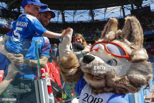Mascotte Zabivaka gives a high five to a young fan of Iceland during the 2018 FIFA World Cup Russia group D match between Argentina and Iceland at...