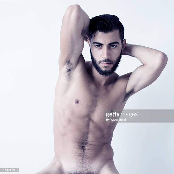 Masculine bearded guy posing naked