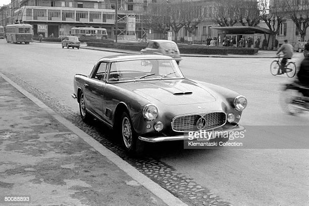 A Maserati 3500GT on the Via Emilia in the center of Modena circa 1960